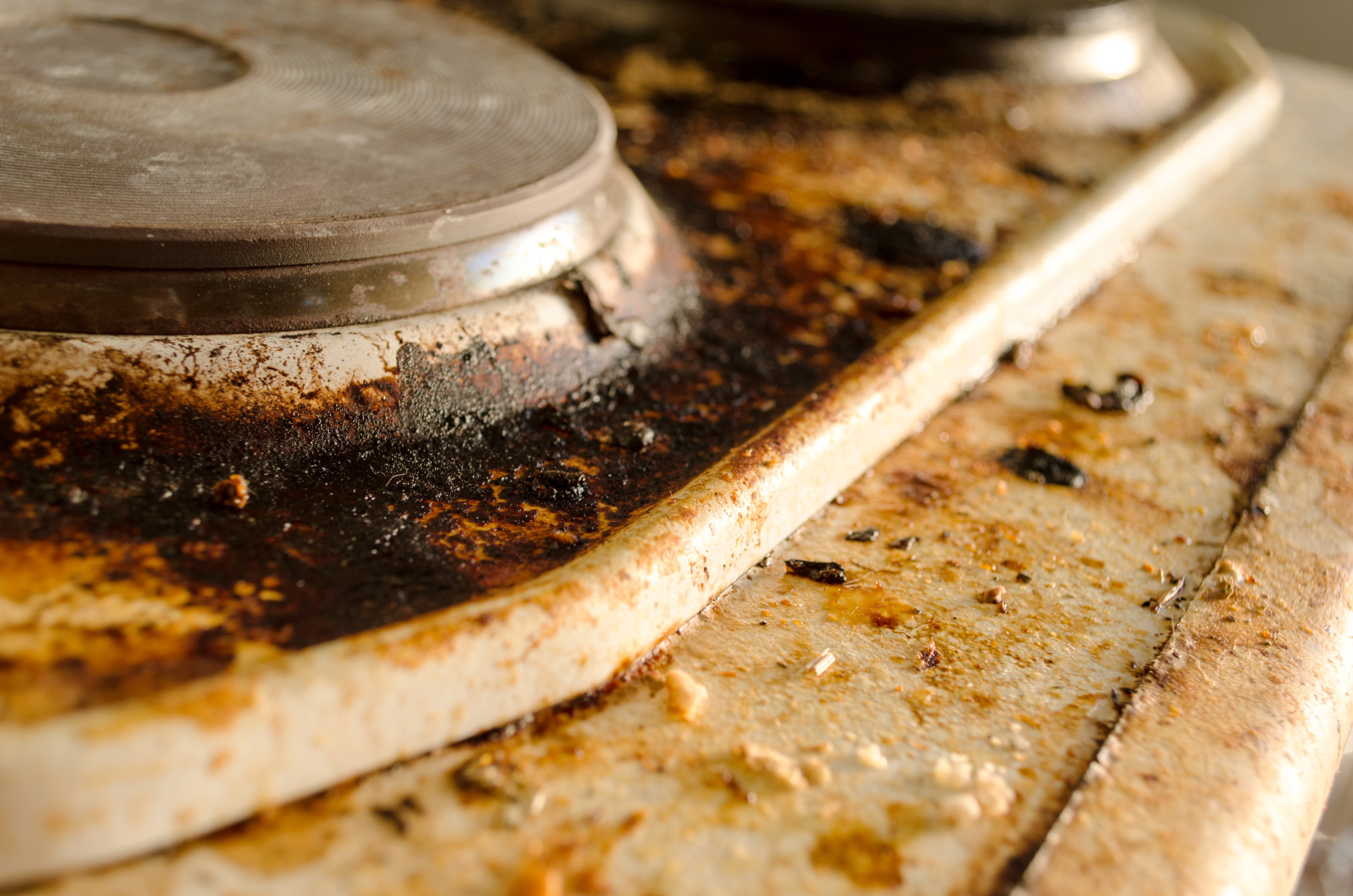 how to deep clean a stovetop
